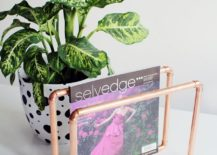 A-slim-magazine-rack-in-copper-for-your-cool-coffee-table-217x155