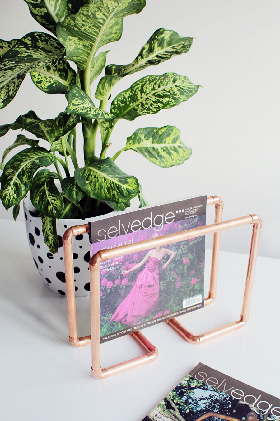 A-slim-magazine-rack-in-copper-for-your-cool-coffee-table