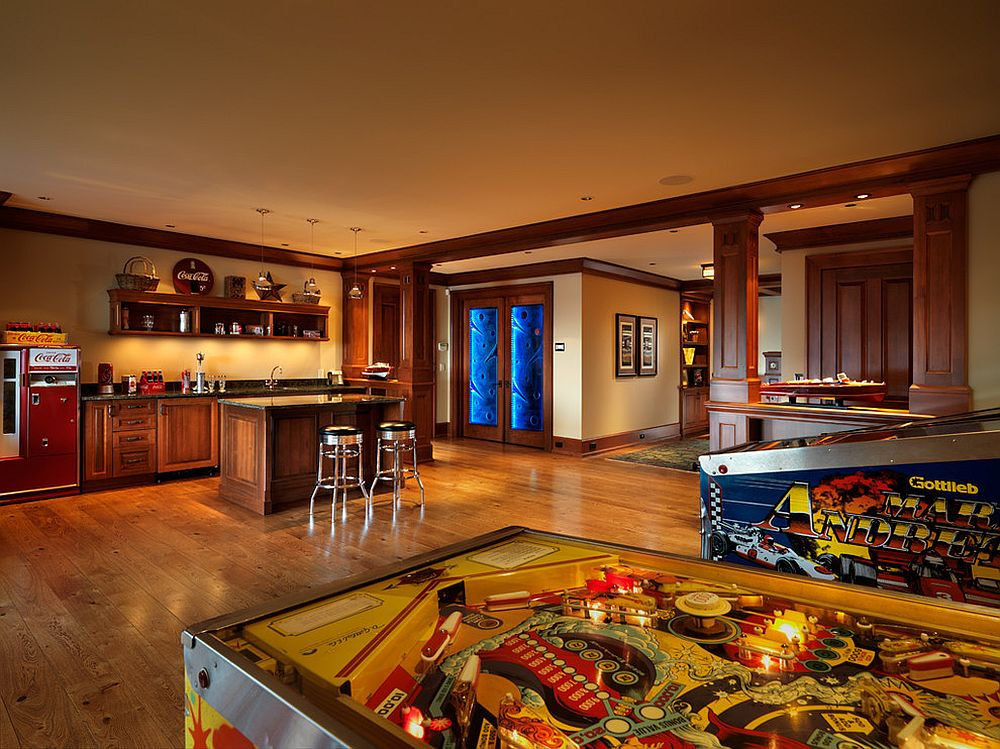 Basement bar and family room with pinball machines