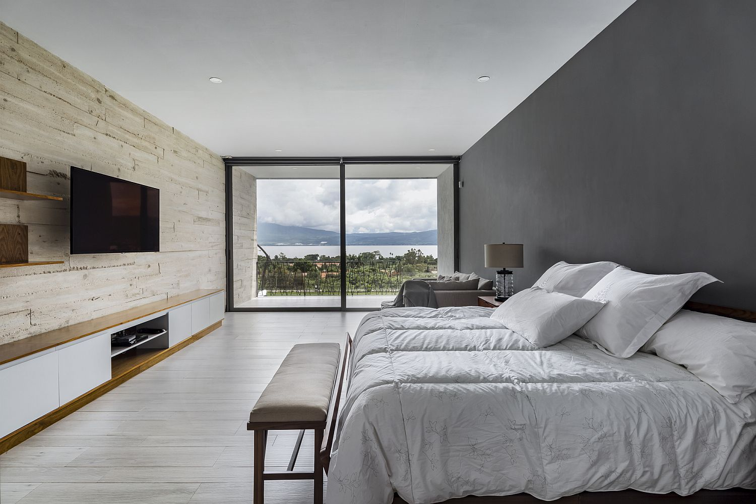Bedroom of the Lake House with accent wooden wall and a lovely view
