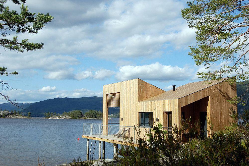 Cabin-in-pinewood-on-waters-edge