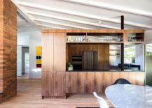 Cabinets-and-shelves-create-a-room-within-a-room-217x155