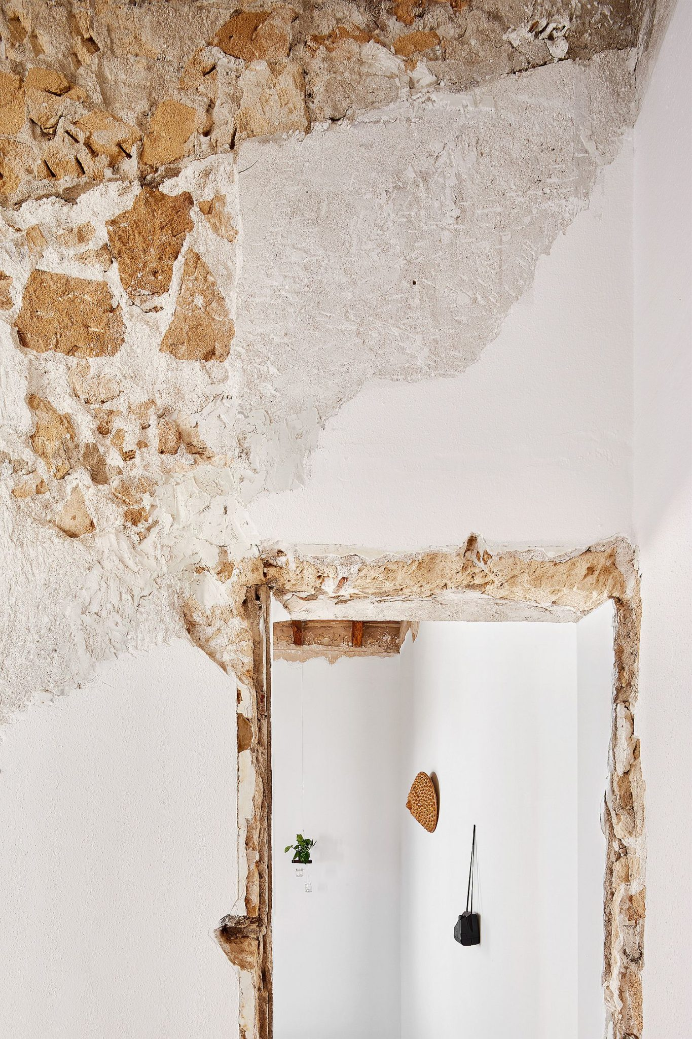 Carefully restore home in Spain on a budget with walls that have a distressed finish