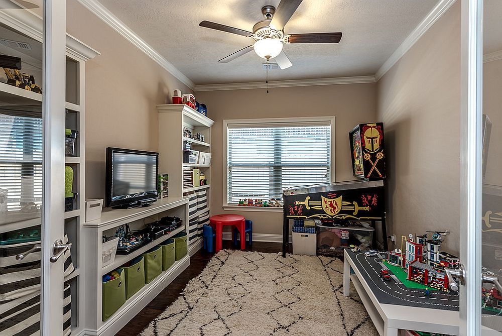 Cheerful kids' playroom with pinball machine in the corner