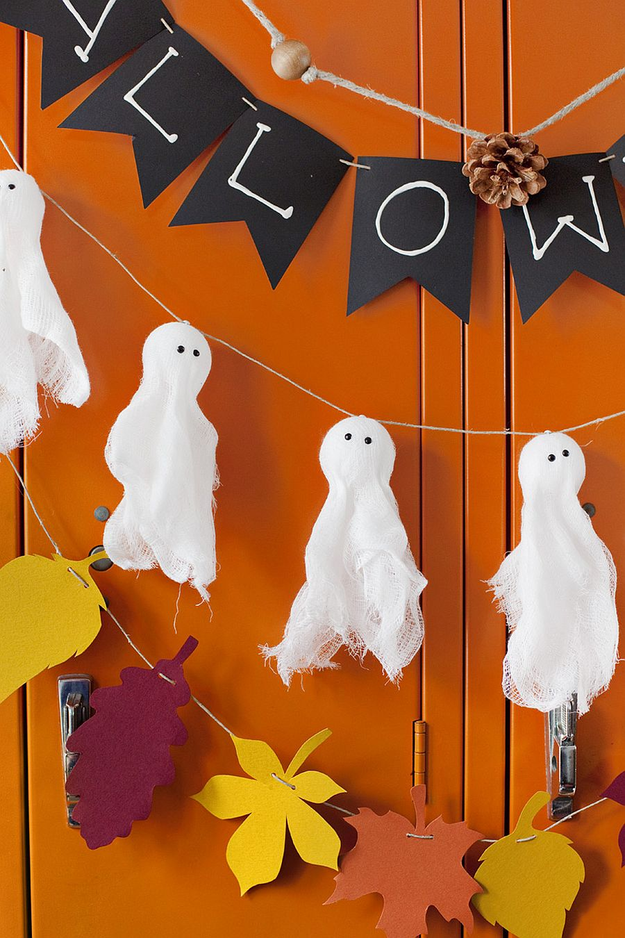 Combine different garlands to create a stunning front porch this Halloween