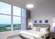 Comfortable-modern-bedroom-in-white-with-an-ocean-view-217x155
