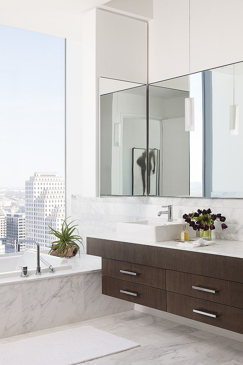 Contemporary bathroom draped in wood and marble with stunning views of downtown Austin and beyond