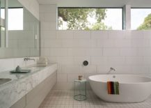 Contemporary-bathroom-in-white-with-spa-styled-ambiance-and-marble-vanity-217x155