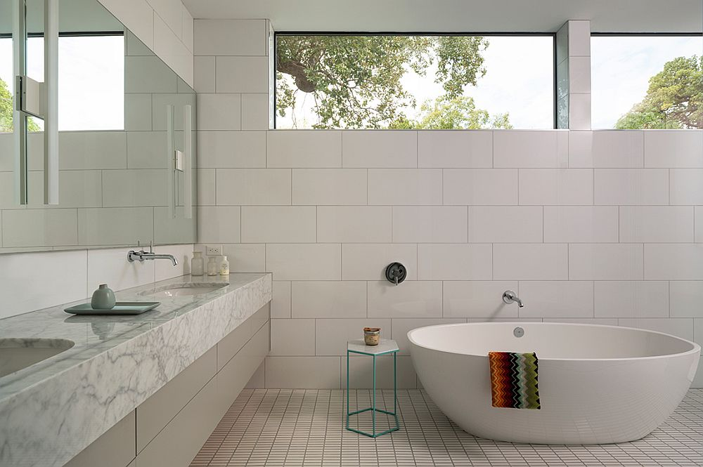 Contemporary bathroom in white with spa-styled ambiance and marble vanity