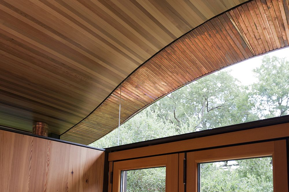 Curved roof of the poolhouse also brings in ample natural light