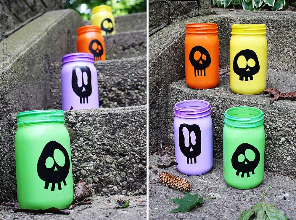 DIY painted skull luminaries crafted using mason jars