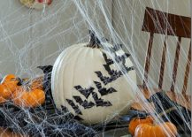 Decorating-with-bats-across-a-white-pumpkin-is-a-great-way-to-create-a-chic-Halloween-table-217x155