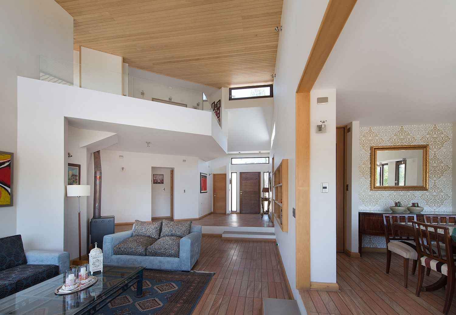 Double-height central living are and dining room of the home in Chile