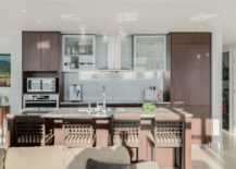 Elegant-and-efficinet-kitchen-in-white-with-brown-wooden-cabinets-217x155