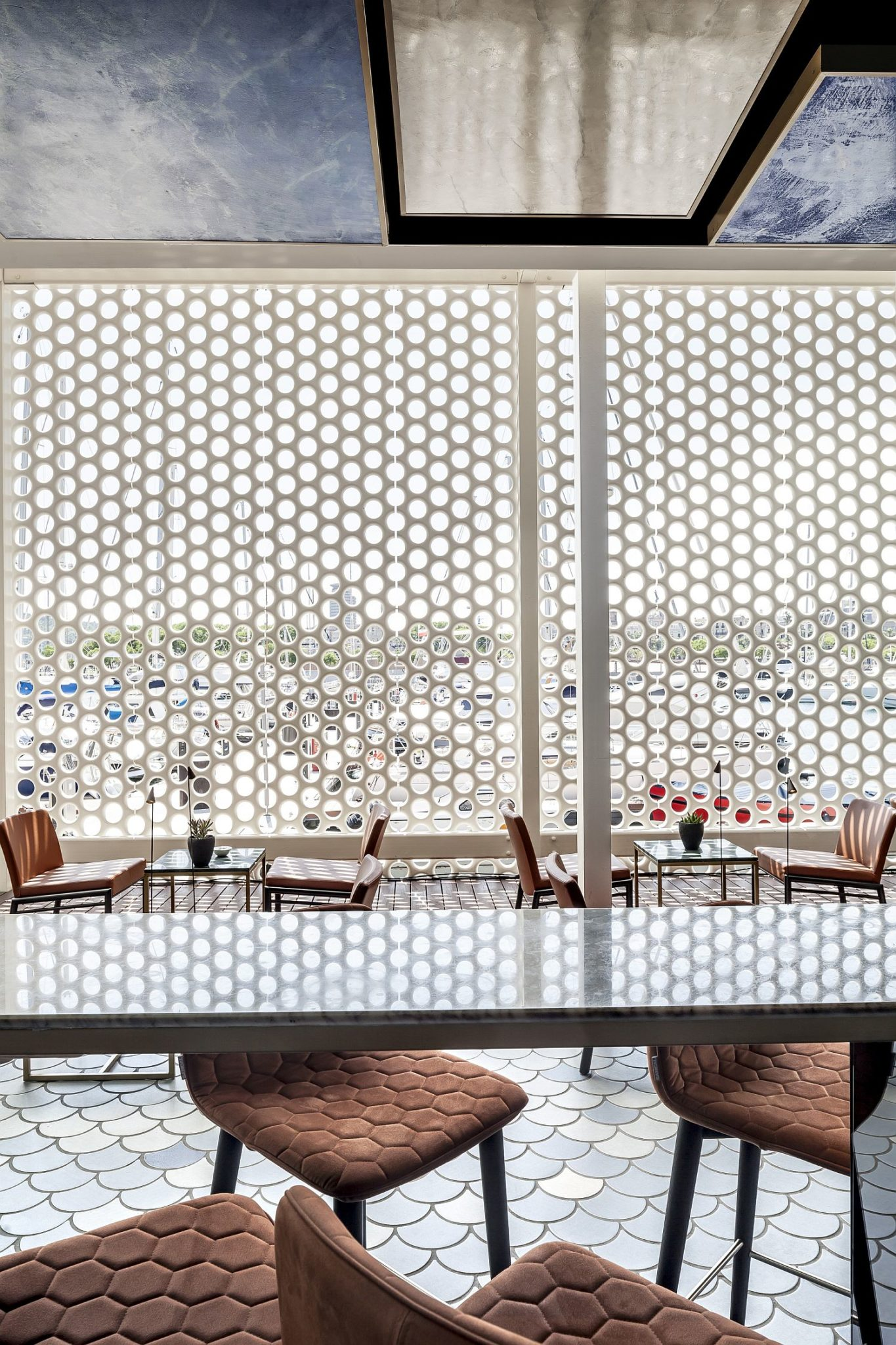 Existing white lattice of the building is carefully intertwined with the bar design