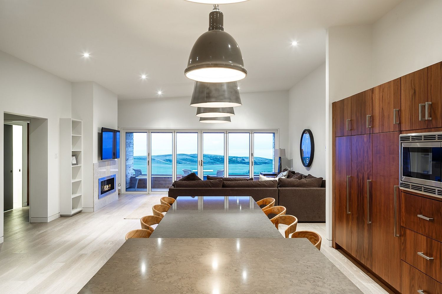 Expansive and open dining room next to living area with ocean views