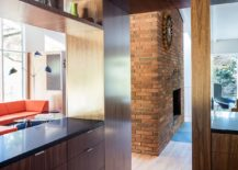 Exposed-brick-wall-fireplace-for-the-living-area-217x155