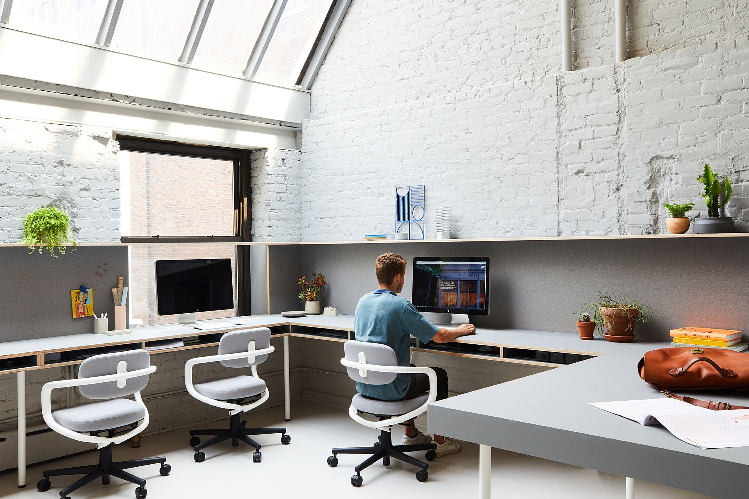 Exposed brick walls and skylights shape a unqiue office space