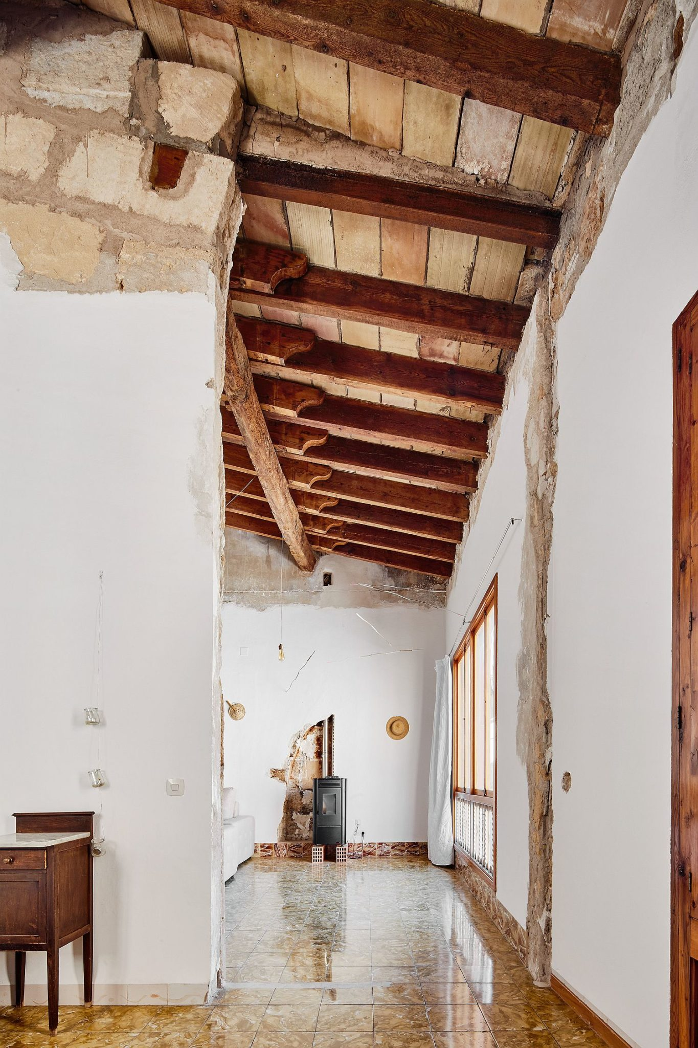 Exposed wooden ceiling and walls give the interior a new look