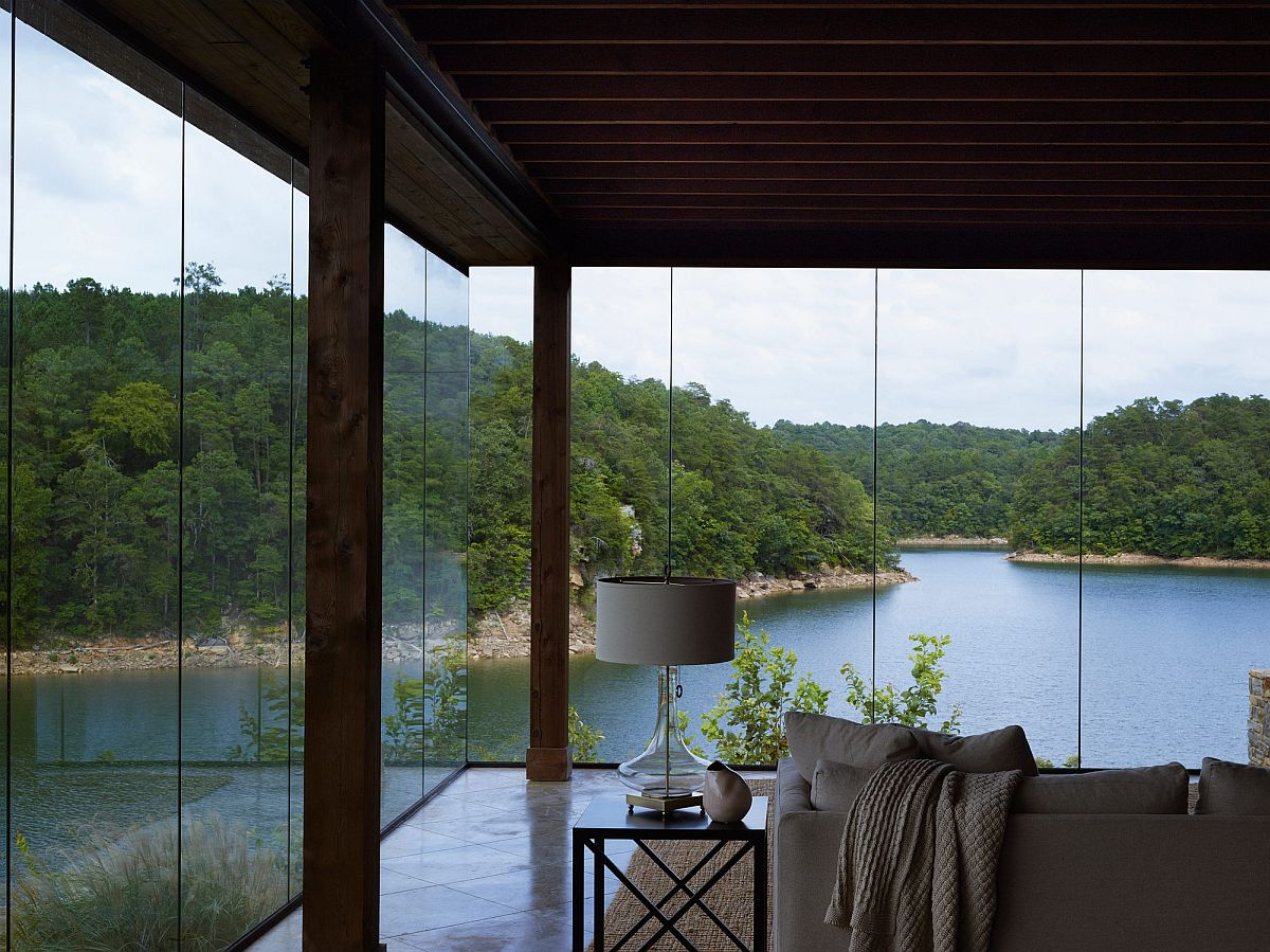 Frameless walls of glass turn the stunning outdoors into backdrop for the interior