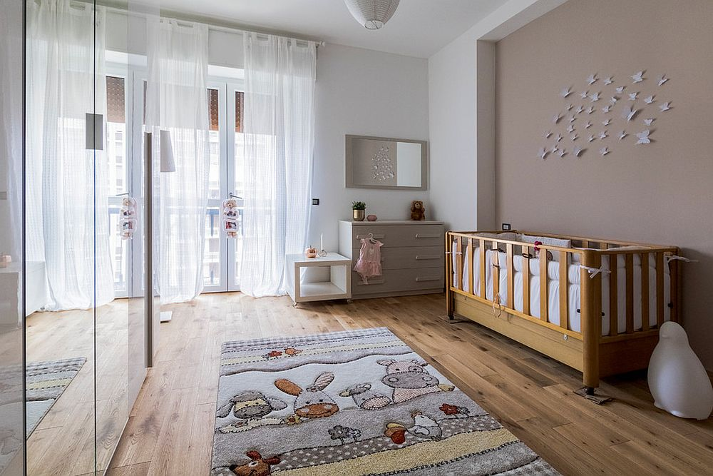It is the delightful rug that steals the show in this modern nursery