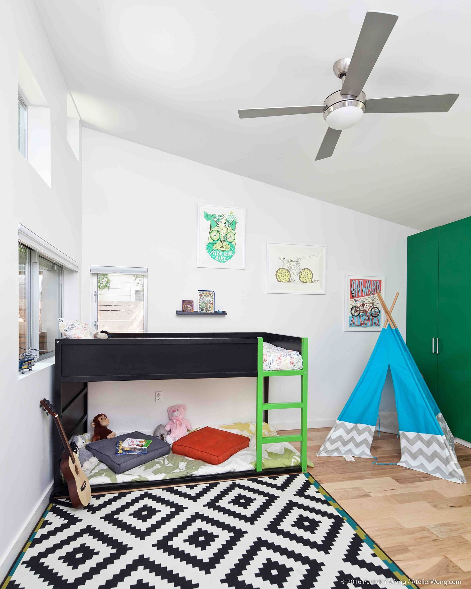 Kids' bedroom with modern bunk bed, snazzy rug and a teepee in the corner