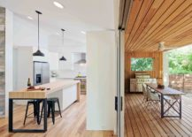 Kitchen-connected-with-the-wooden-deck-outside-has-an-extended-breakfast-zone-217x155