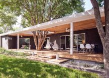Large-porch-of-the-Texas-home-with-hanging-chairs-and-outdoor-dining-217x155