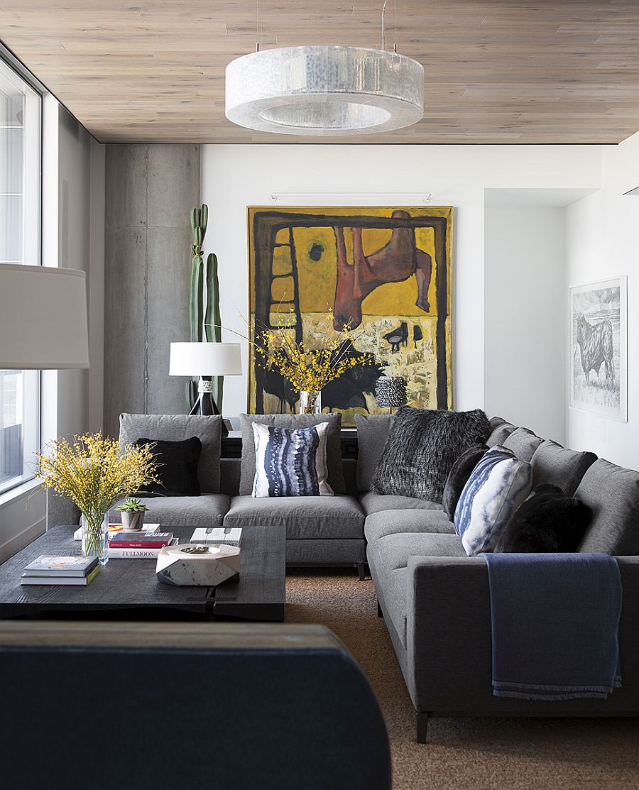 Living room with a comfortable gray couch and a custom coffee table