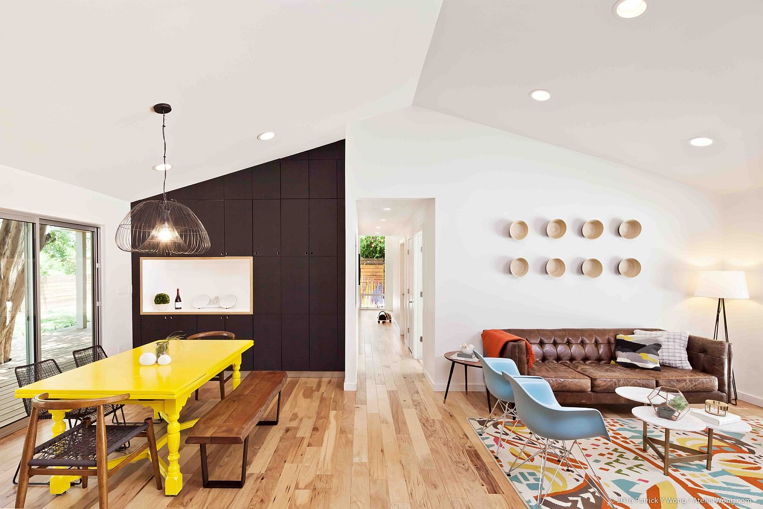 Modern and light-filled living area with pops of bright color