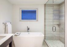 Modern-beathroom-in-white-with-standalone-bathtub-217x155