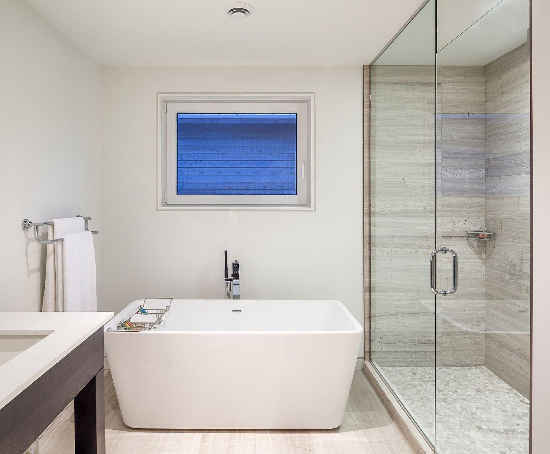 Modern bathroom in white with standalone bathtub