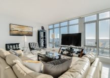 Modern-decor-and-relaxing-couch-give-the-living-space-a-breezy-cheerful-look-217x155