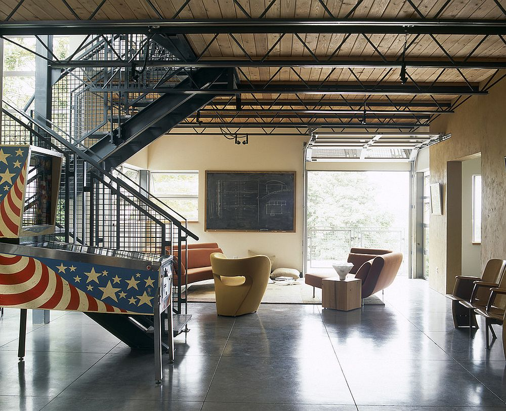 Modern industrial living room with pinball machine in stars and stripes
