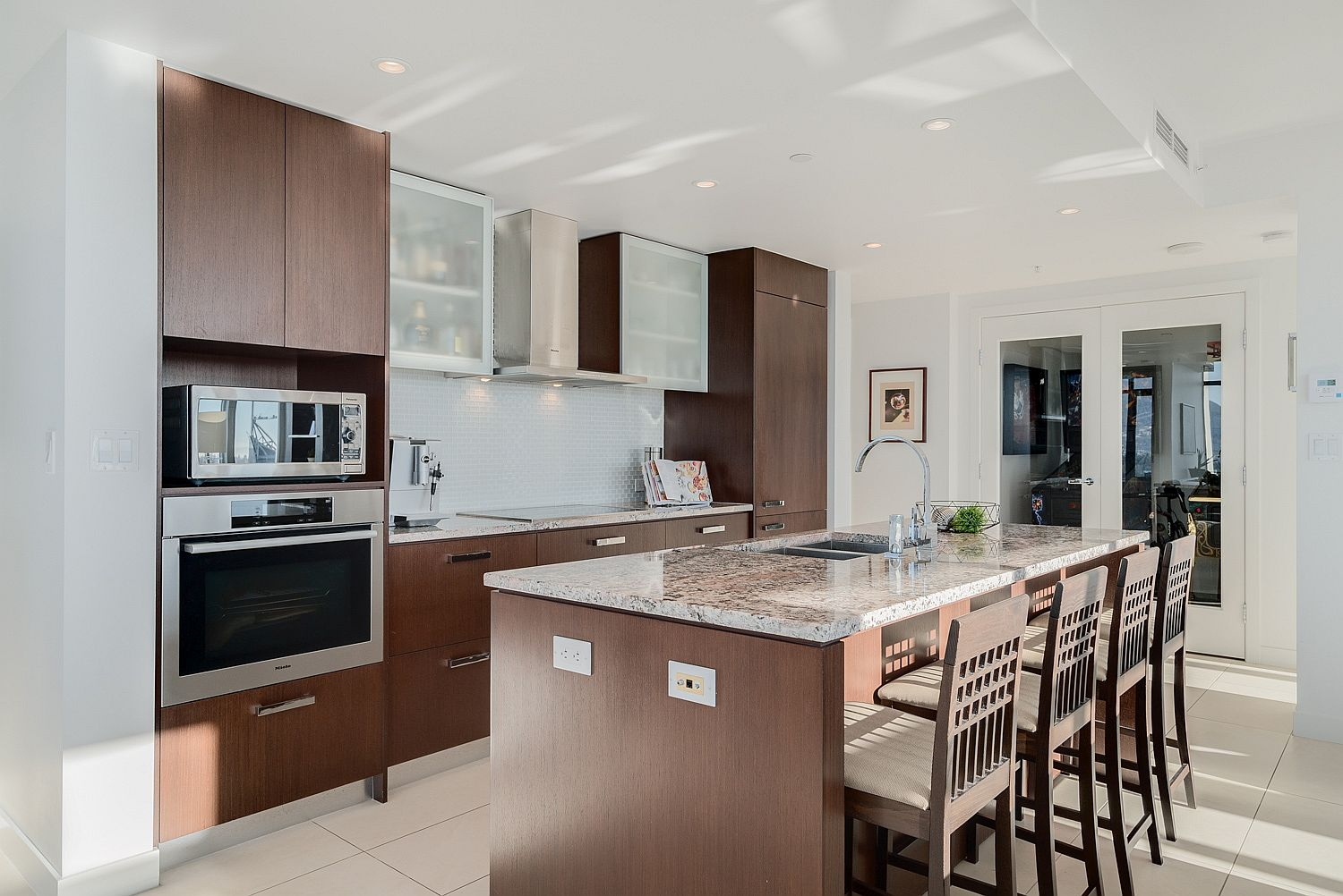 Modern kitchen with smart shelving, state-of-the-art appliances and space-savvy design