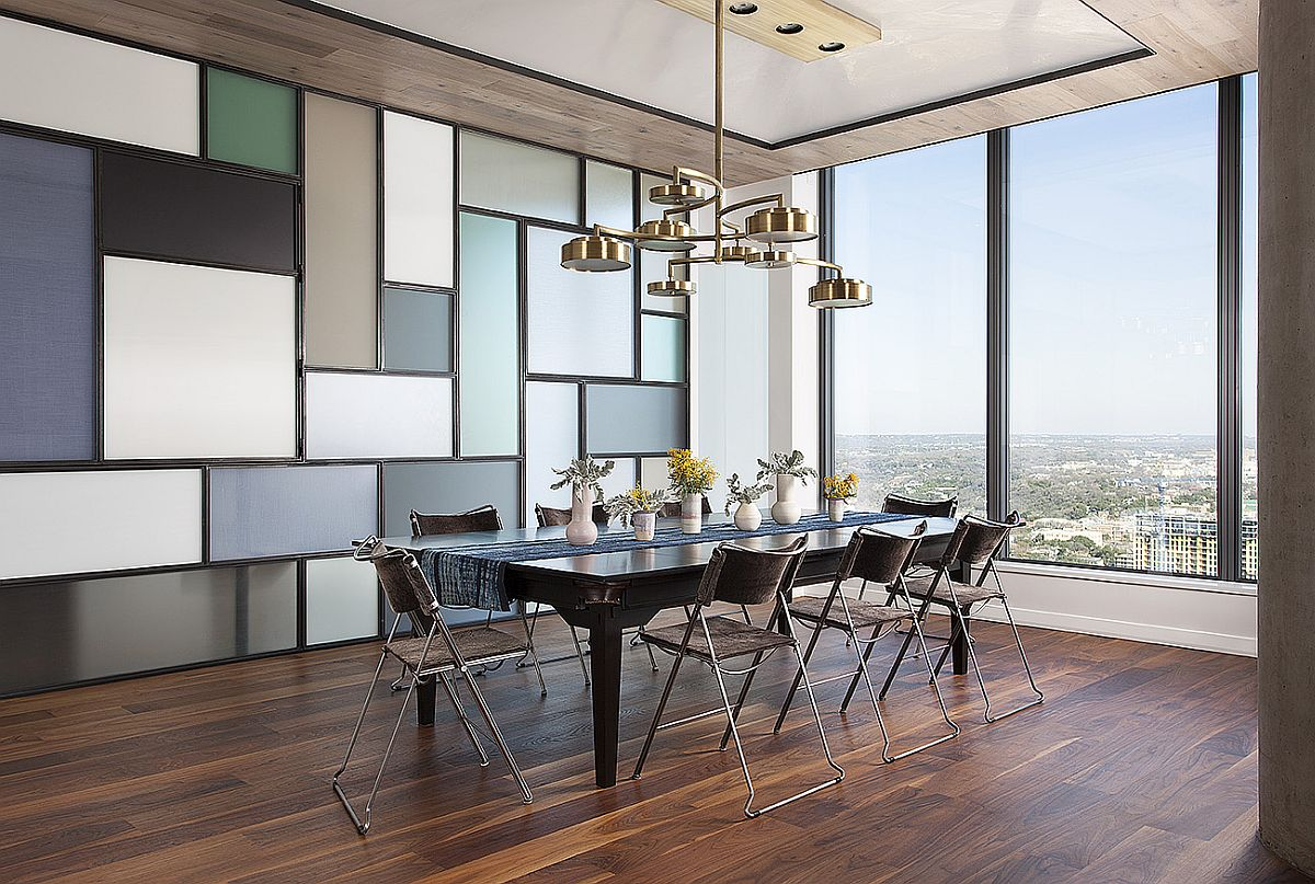 Multi-tasking dining room with a dining table and chandelier that transform into pool table lighting and pool table