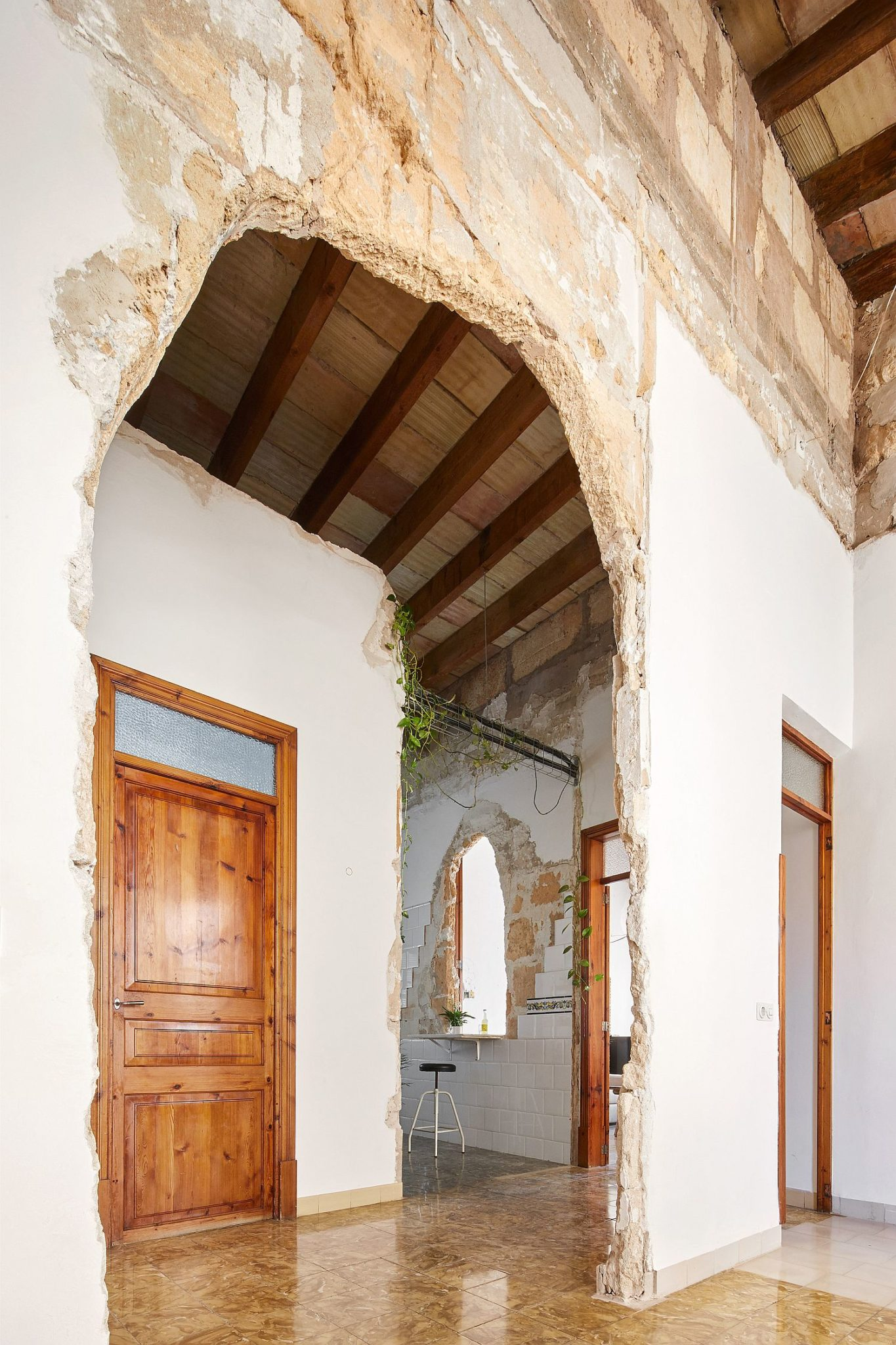 Old archways are left intact and accentuated to create visual contrast