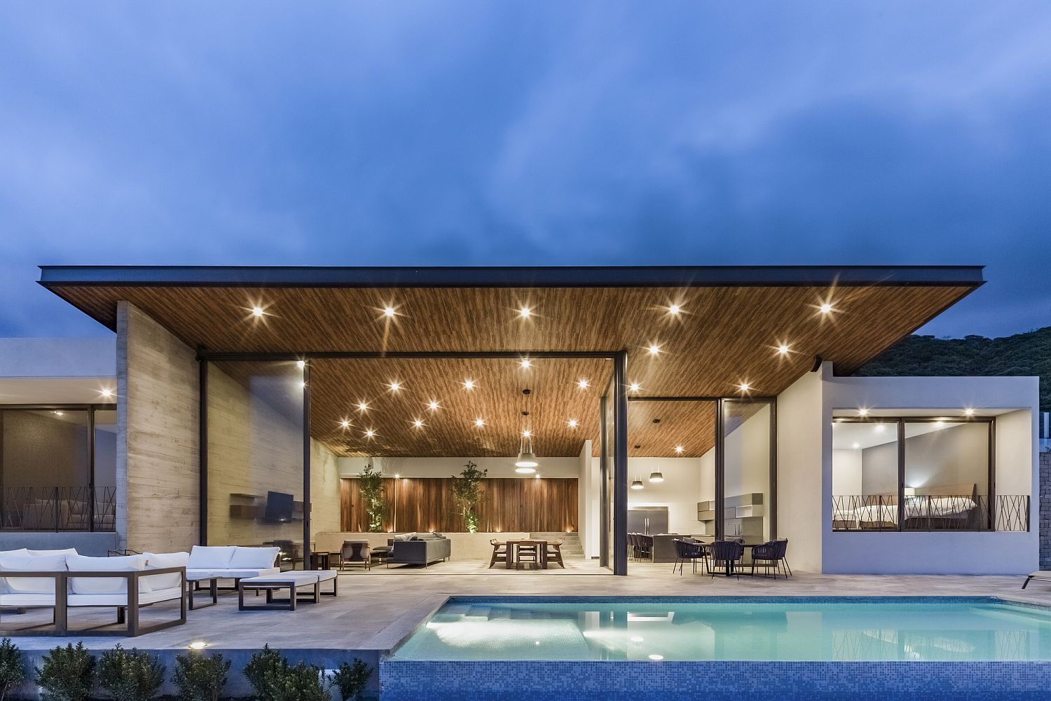Overhang of the home offers ample natural shade along with cool lighting after sunset