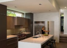 Polished-kitchen-with-pantry-and-a-large-central-island-217x155