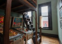 Reclaimed-loft-with-modern-industrial-vibe-features-pinball-machines-under-the-bed-217x155