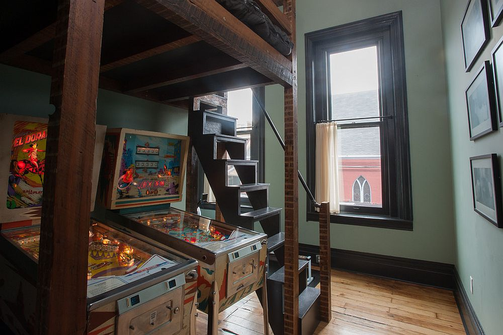 Reclaimed loft with modern industrial vibe features pinball machines under the bed