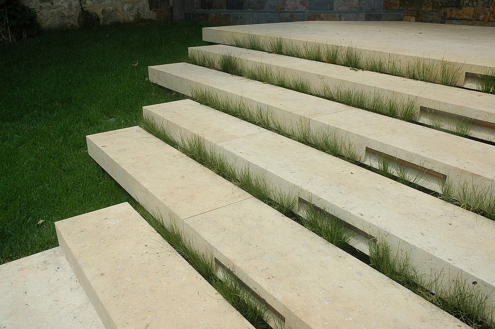 Simple stone steps leading to the poolhouse