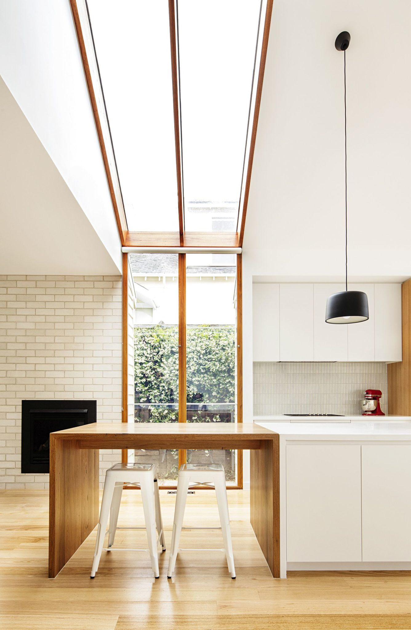 Skylights and smart windows bring ample light into the kitchen
