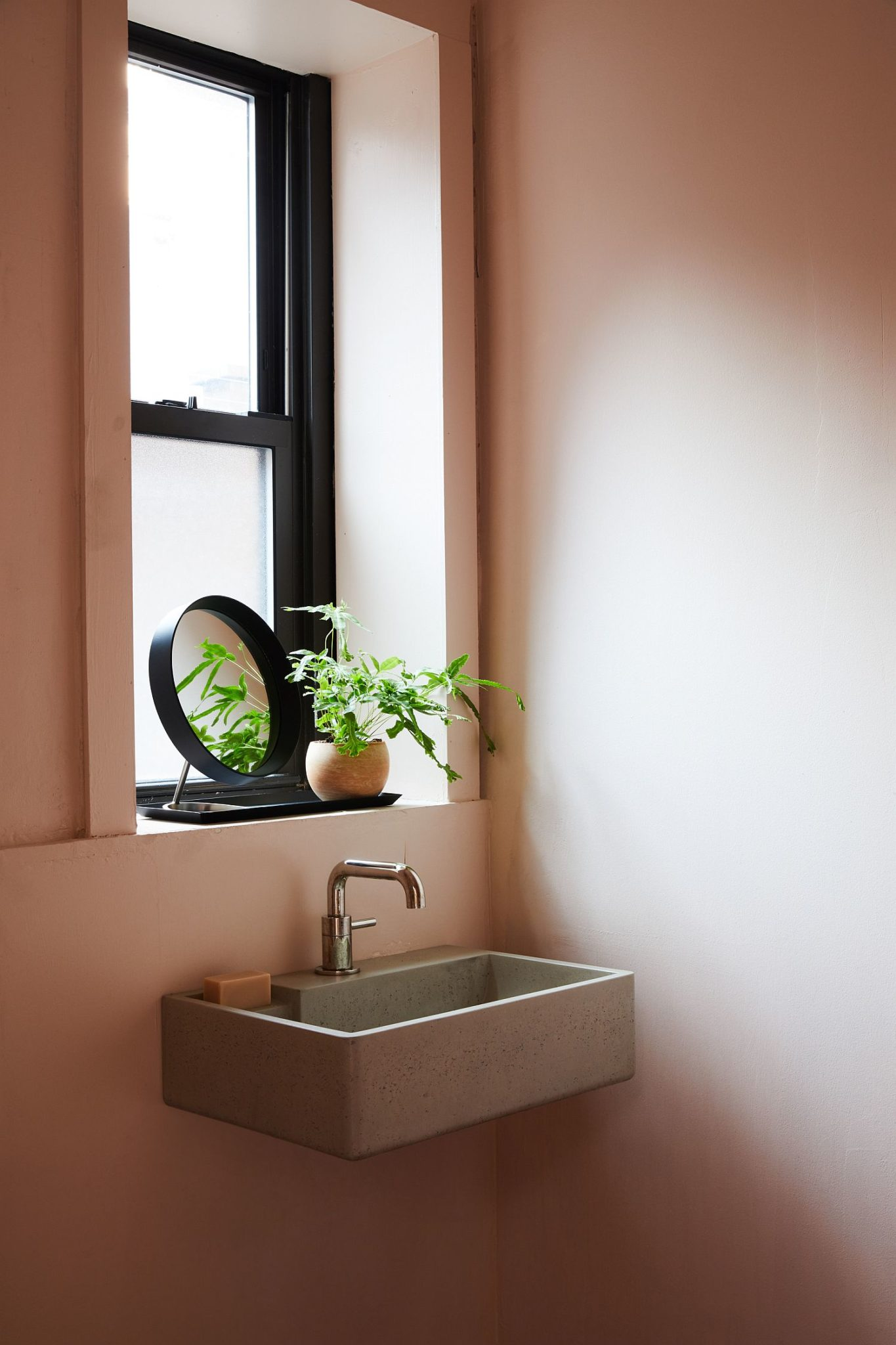 Small sink in the corner is a smart space-saver