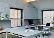 Smart-lighting-and-sloped-ceiling-give-the-office-a-gorgeous-look-217x155