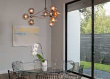 Sparkling-chandelier-becomes-the-focal-point-of-the-dining-area-217x155