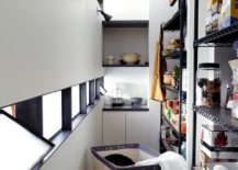 Squeezing-in-the-laundry-basket-on-wheels-into-the-narrow-kitchen-217x155