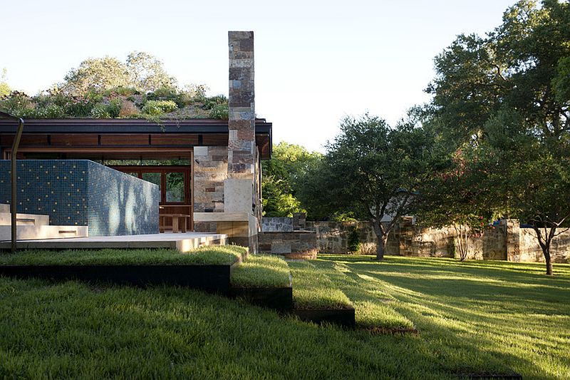 Steps draped in green add to the eco-friendly design of the poolhouse in Texas