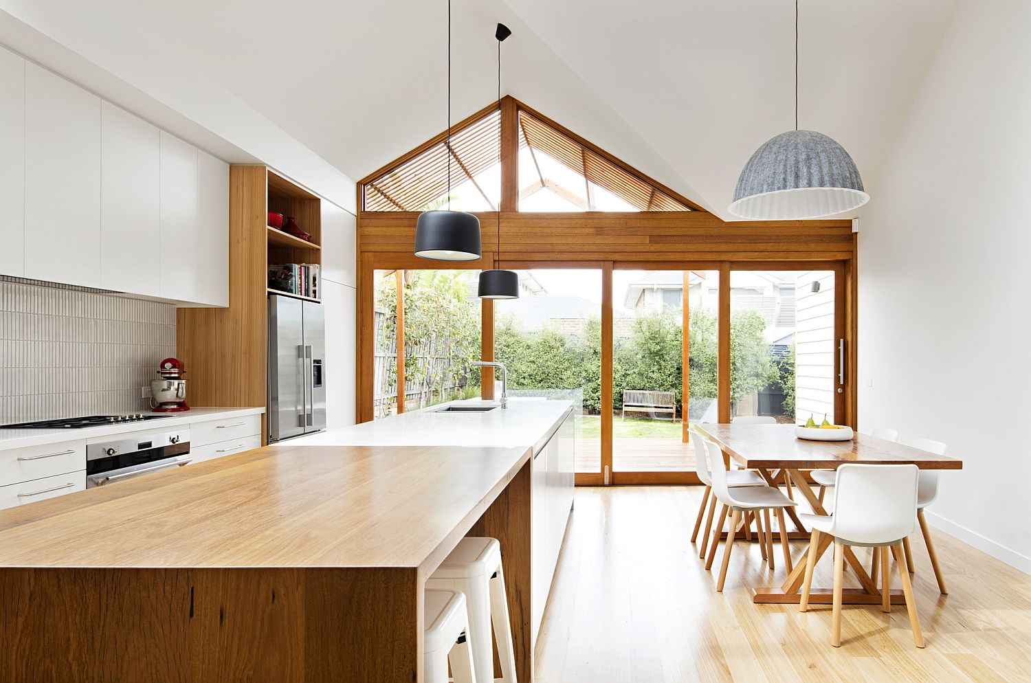 Striking pendants blend into the modern theme of the kitchen
