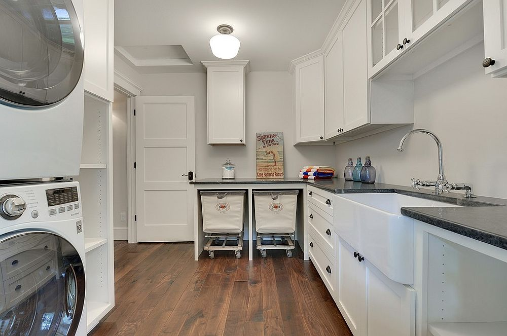 Transitional laundry room with baskets on wheels
